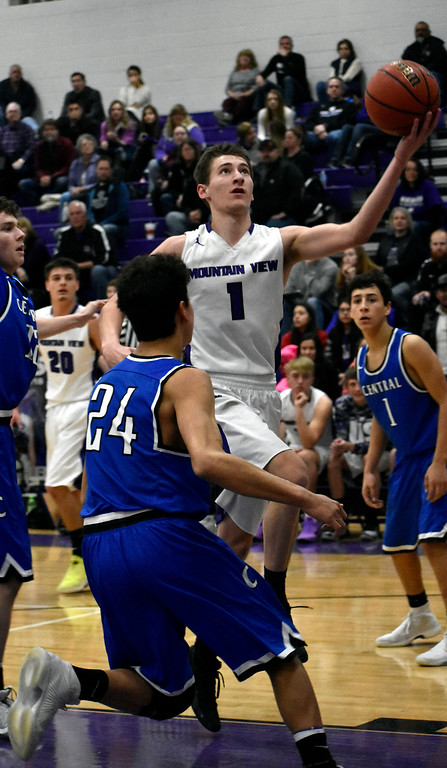 . Mountain View\'s (1) Dyson Bassett goes for a jump shot before Pueblo\'s (24) Nico Martin can block him during their game on Wednesday, Feb. 21, 2018 at Mountain View High School in Loveland. Photo by Thieng Mai/Loveland Reporter-Herald.