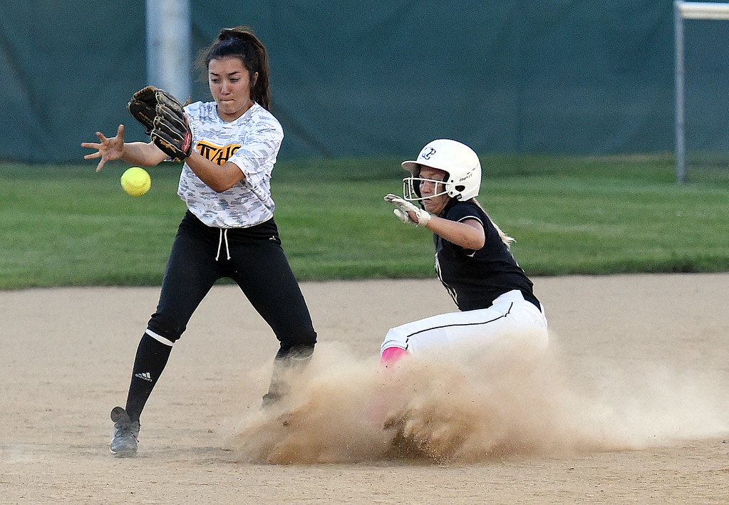 . Mountain View\'s (2) Kamryn Leoffler slides safely into second as Thompson Valley\'s (7) Kiara Demare tries to catch the ball during their game Wednesday, Sept. 12, 2018, at Centennial Field in Loveland.  (Photo by Jenny Sparks/Loveland Reporter-Herald)
