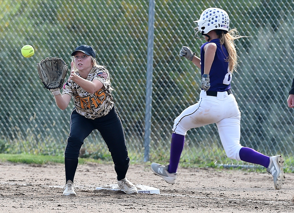 . Thompson Valley\'s (3) Sydnie Wagonmaker catches the ball as Mountain View\'s (8) Jaycee Schroeder tries to get to first Tuesday, Sept. 26, 2017, during their at Mountain View in Loveland.  (Photo by Jenny Sparks/Loveland Reporter-Herald)