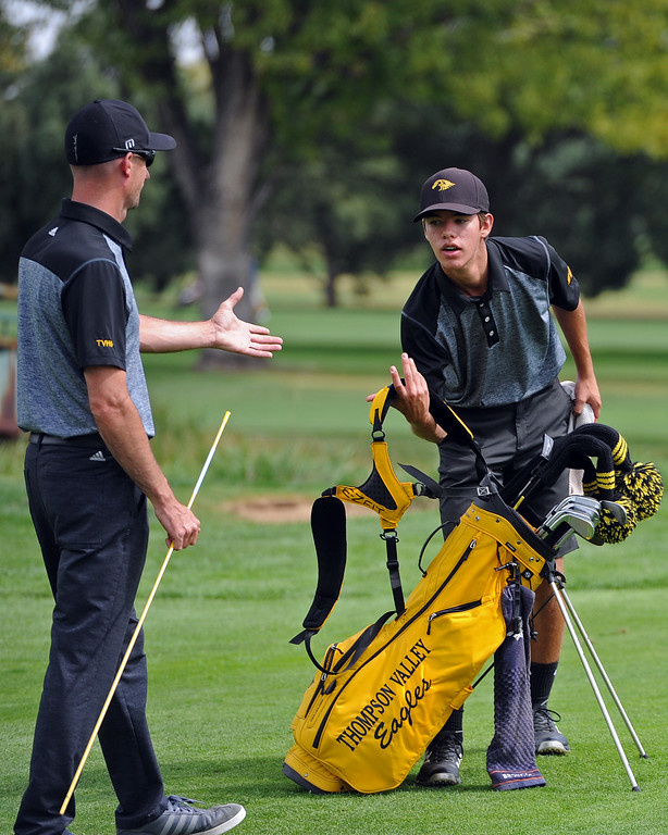 . Thompson Valley coach Derek Shagin, left, goes to give Mason Magley a high-five during the 4A Region 3 Tournament at the Olde Course at Loveland on Wednesday, Sept. 19, 2018. (Sean Star/Loveland Reporter-Herald)