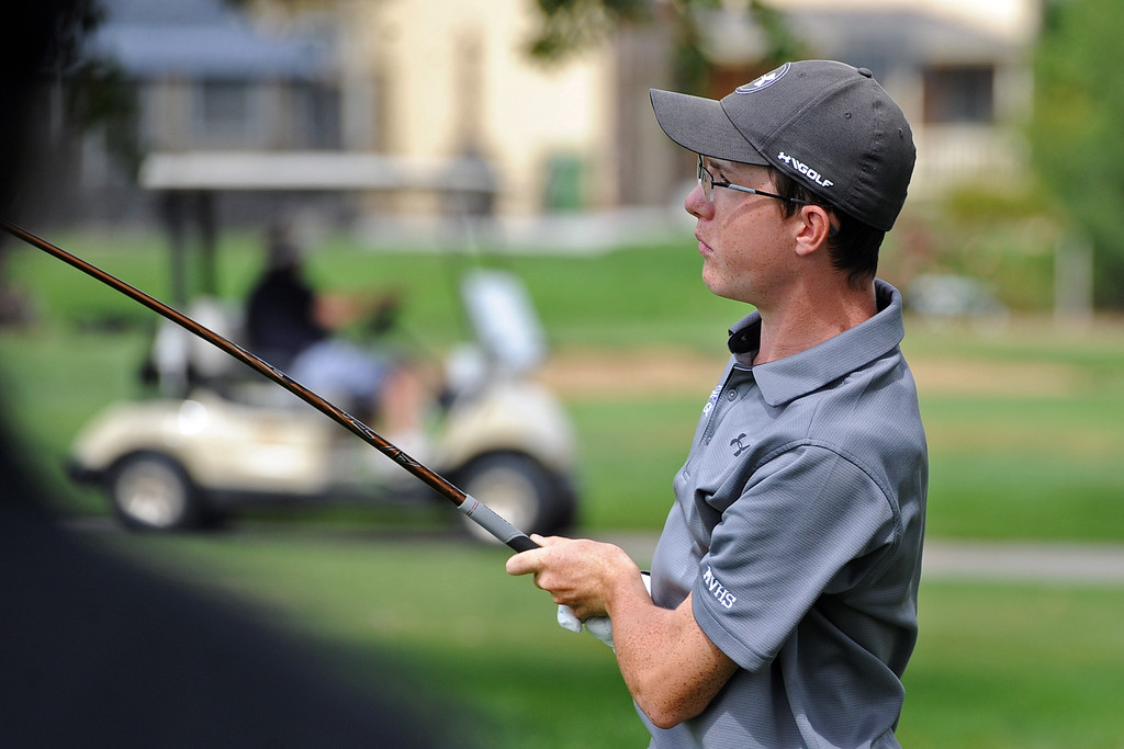 . Mountain View\'s Gavin McWhorter watches his tee shot on the 12 hole during the 4A Region 3 Tournament at the Olde Course at Loveland on Wednesday, Sept. 19, 2018. (Sean Star/Loveland Reporter-Herald)