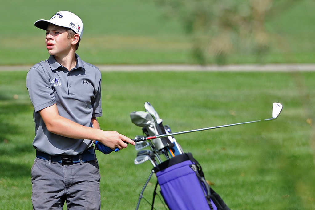 . Mountain View\'s Lochlan McNair watches his approach shot on the 12th hole during the 4A Region 3 Tournament at the Olde Course at Loveland on Wednesday, Sept. 19, 2018. (Sean Star/Loveland Reporter-Herald)
