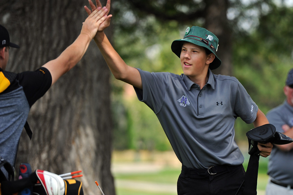 . Mountain View\'s Drew Visocky, right, high-fives Thompson Valley\'s Whit Hewett on the 12th tee box during the 4A Region 3 Tournament at the Olde Course at Loveland on Wednesday, Sept. 19, 2018. (Sean Star/Loveland Reporter-Herald)