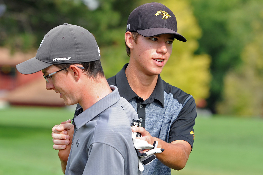 . Thompson Valley\'s Mason Magley, right, is congratulated by Mountain View\'s Gavin McWhorter following a playoff during the 4A Region 3 Tournament at the Olde Course at Loveland on Wednesday, Sept. 19, 2018. (Sean Star/Loveland Reporter-Herald)