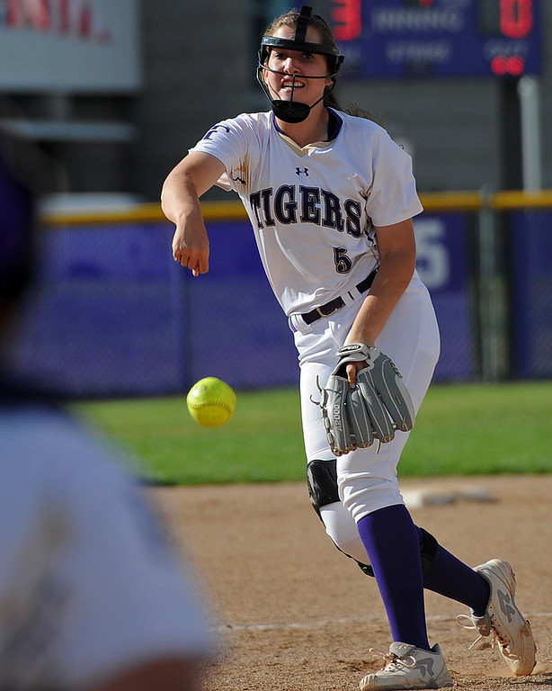 . Holy Family\'s Erin Caviness pitches during a game Tuesday, September, 11, 2018 at Holy Family High School in Broomfield, Colorado. (Sean Star/Loveland Reporter-Herald)during a game Tuesday, September, 11, 2018 at Holy Family High School in Broomfield, Colorado. (Sean Star/Loveland Reporter-Herald)