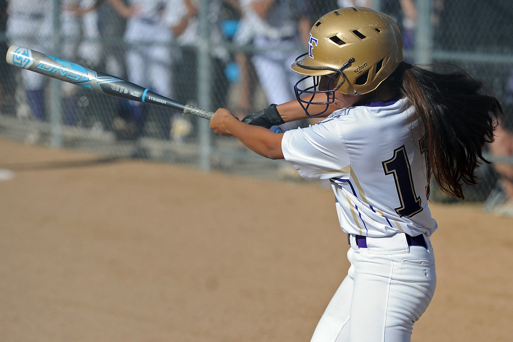 . Holy Family\'s Anna Martinez swings during a game Tuesday, September, 11, 2018 at Holy Family High School in Broomfield, Colorado. (Sean Star/Loveland Reporter-Herald)