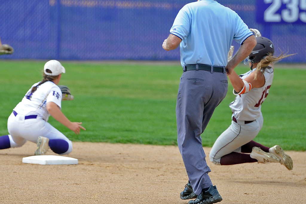 . Berthoud\'s Addi Spears (15) slides safely into second base for a double as Holy Family\'s Sara Rode waits for a throw during a game Tuesday, September, 11, 2018 at Holy Family High School in Broomfield, Colorado. (Sean Star/Loveland Reporter-Herald)