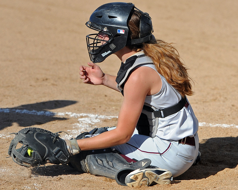 . Berthoud\'s Mandi Laib scoops a pitch during a game Tuesday, September, 11, 2018 at Holy Family High School in Broomfield, Colorado. (Sean Star/Loveland Reporter-Herald)