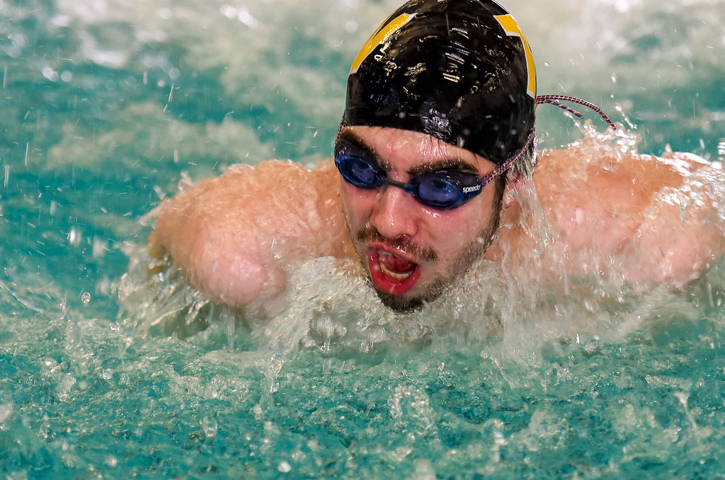. Thompson Valley\'s Benjamin Smith swims the 100-yard butterfly during the City Swim Meet on Wednesday April 11, 2018 at the MVAC. (Cris Tiller / Loveland Reporter-Herald)