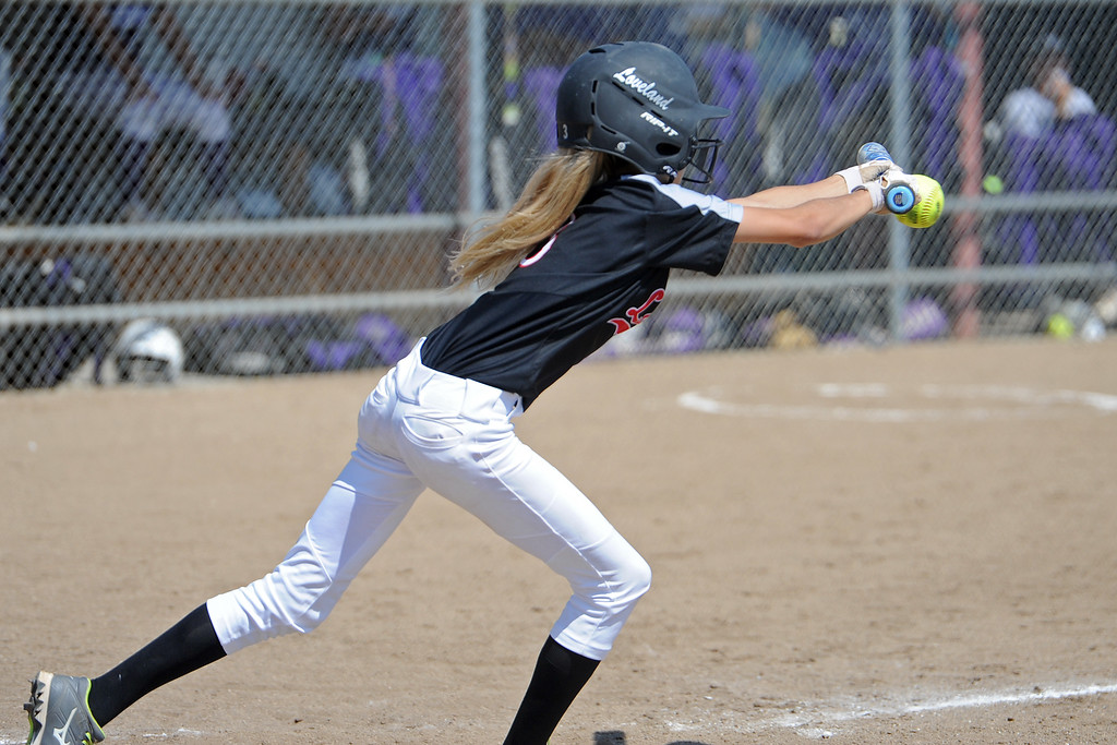 . Loveland\'s Avery Buhler bunts during a game Saturday, Sept. 8, 2018 at Mountain View High School in Loveland. (Sean Star/Loveland Reporter-Herald)