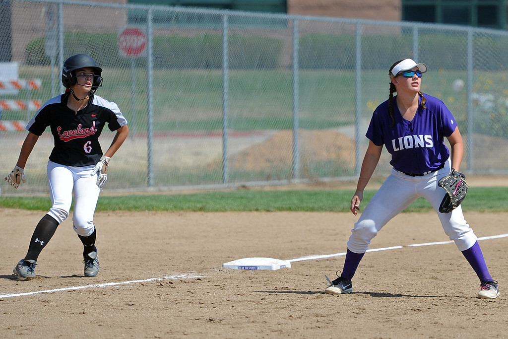 . Loveland\'s Kammrie Bakovich, left, and Mountain View\'s RaLeigh Basart track a fly ball during a game Saturday, Sept. 8, 2018 at Mountain View High School in Loveland. (Sean Star/Loveland Reporter-Herald)