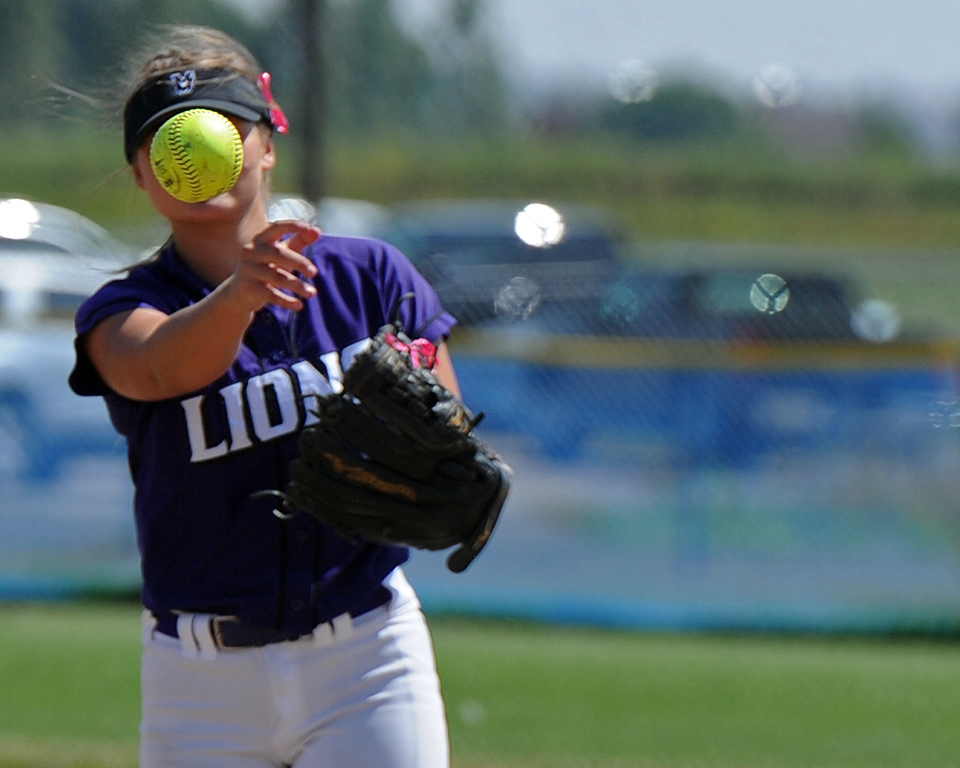 . Mountain View\'s Morgan Jewell throws to first during a game Saturday, Sept. 8, 2018 at Mountain View High School in Loveland. (Sean Star/Loveland Reporter-Herald)
