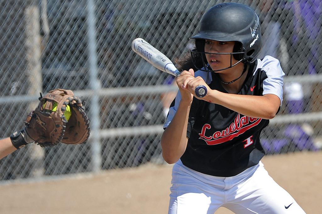 . Loveland\'s Emma Duran watches a ball into the catcher\'s mitt during a game Saturday, Sept. 8, 2018 at Mountain View High School in Loveland. (Sean Star/Loveland Reporter-Herald)