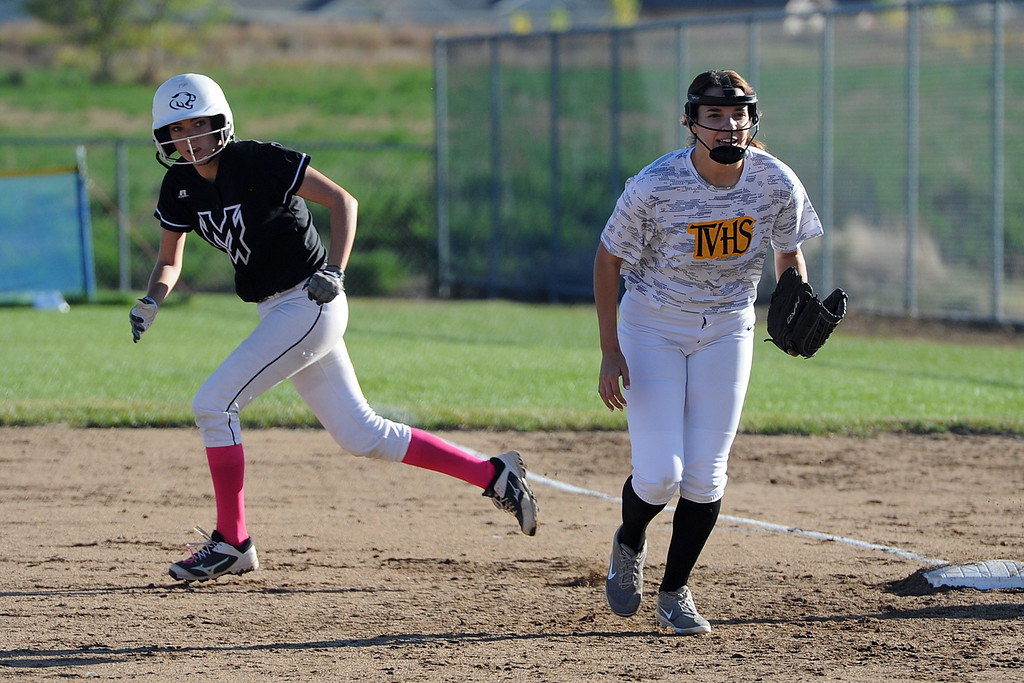 . Mountain View\'s Michelle Pomranka, left, takes off for second as Thompson Valley first baseman Ashton Hornick gets ready for the pitch during their game Thursday, Oct. 4, 2018 at Mountain View High School. (Sean Star/Loveland Reporter-Herald)