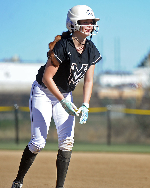 . Mountain View\'s Nicole Rogers smiles after a two-run single during the first day of the 4A state softball tournament on Friday, Oct. 19, 2018 at Aurora Sports Park. (Sean Star/Loveland Reporter-Herald)