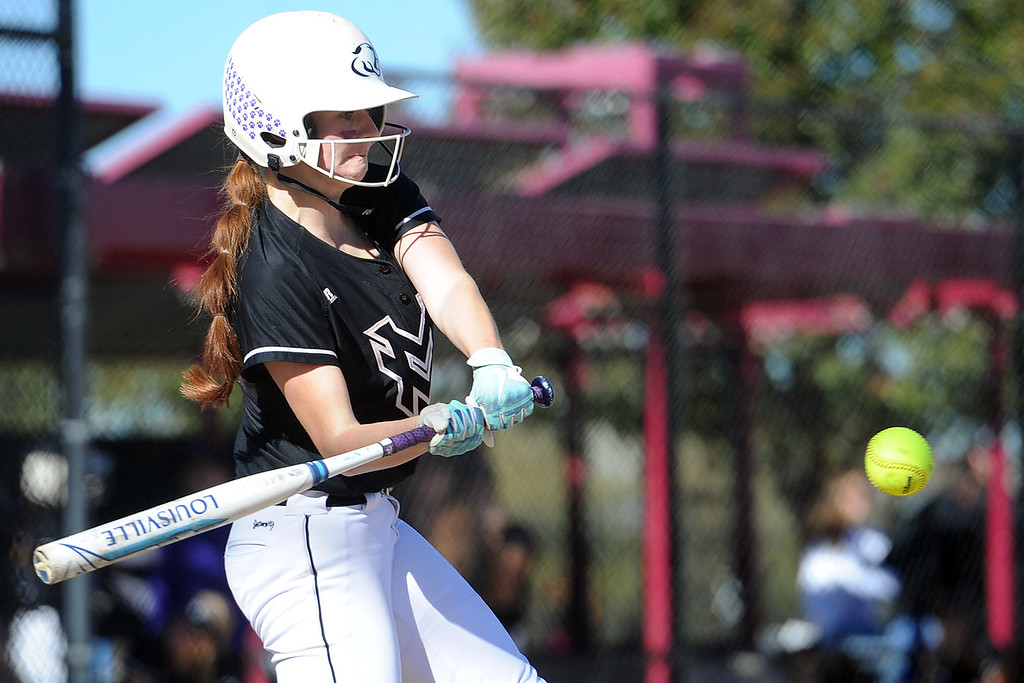 . Mountain View\'s Nicole Rogers keeps her eye on the ball during the first day of the 4A state softball tournament on Friday, Oct. 19, 2018 at Aurora Sports Park. (Sean Star/Loveland Reporter-Herald)