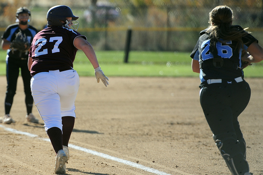 . Berthoud\'s Ashlynn Balliet (27) gets caught in a pickle during the first day of the 4A state softball tournament on Friday, Oct. 19, 2018 at Aurora Sports Park. (Sean Star/Loveland Reporter-Herald)