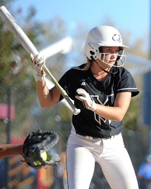 . Mountain View\'s Kamryn Leoffler takes a pitch during the first day of the 4A state softball tournament on Friday, Oct. 19, 2018 at Aurora Sports Park. (Sean Star/Loveland Reporter-Herald)