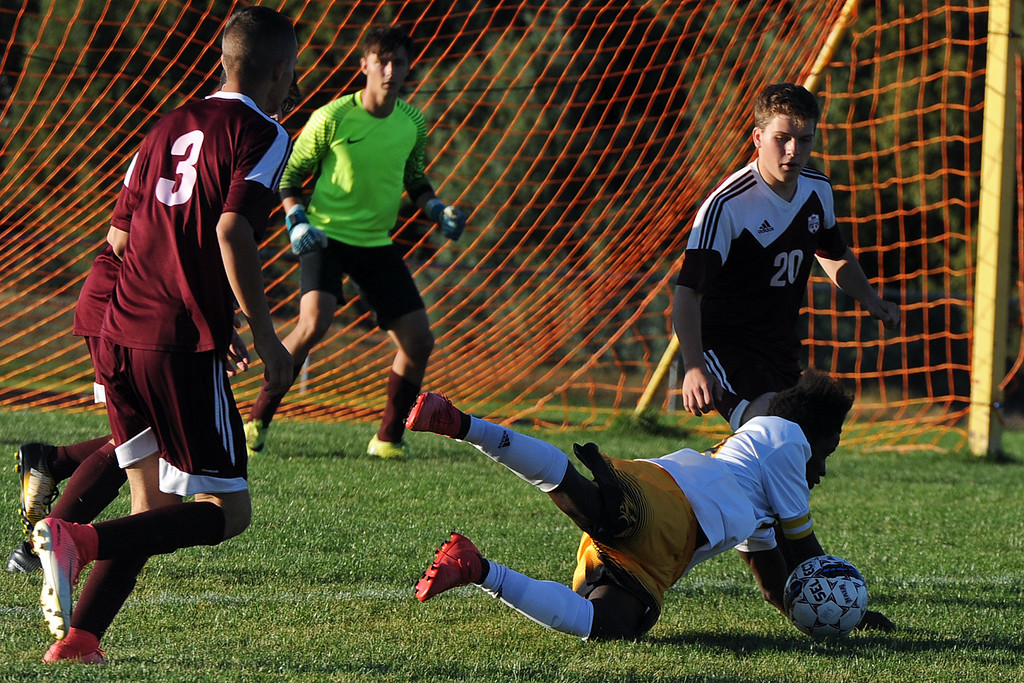 . Thompson Valley\'s Junio Lang gets tripped up as he\'s surrounded by Berthoud defenders during a game Thursday, Sept. 20, 2018 at Berthoud High School. (Sean Star/Loveland Reporter-Herald)