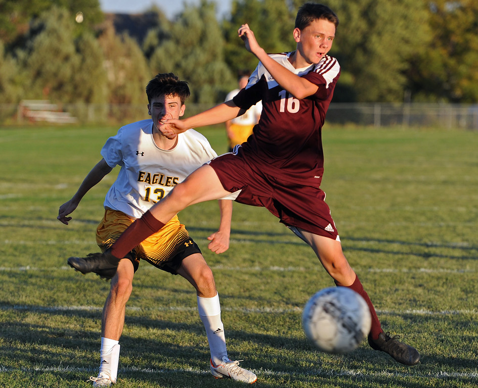 . Berthoud\'s Hudsen Grimditch (16) jumps to stop a shot by Thompson Valley\'s Ian Levin during a game Thursday, Sept. 20, 2018 at Berthoud High School. (Sean Star/Loveland Reporter-Herald)