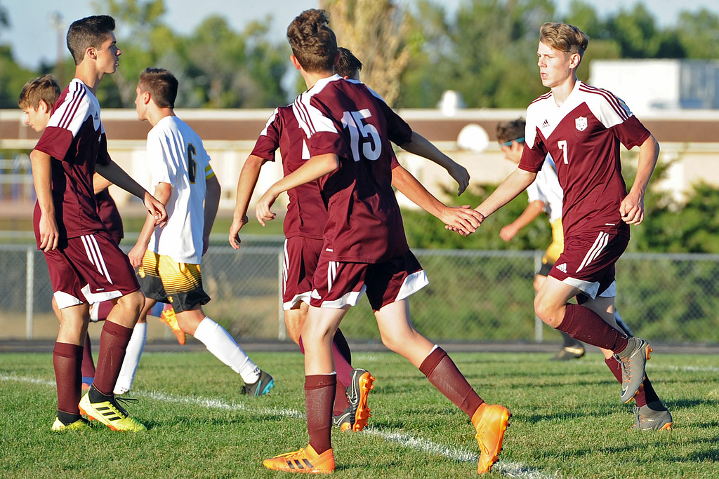 . Berthoud\'s Conrad Ellis , right, is congratulated by teammates after scoring a goal during a game Thursday, Sept. 20, 2018 at Berthoud High School. (Sean Star/Loveland Reporter-Herald)