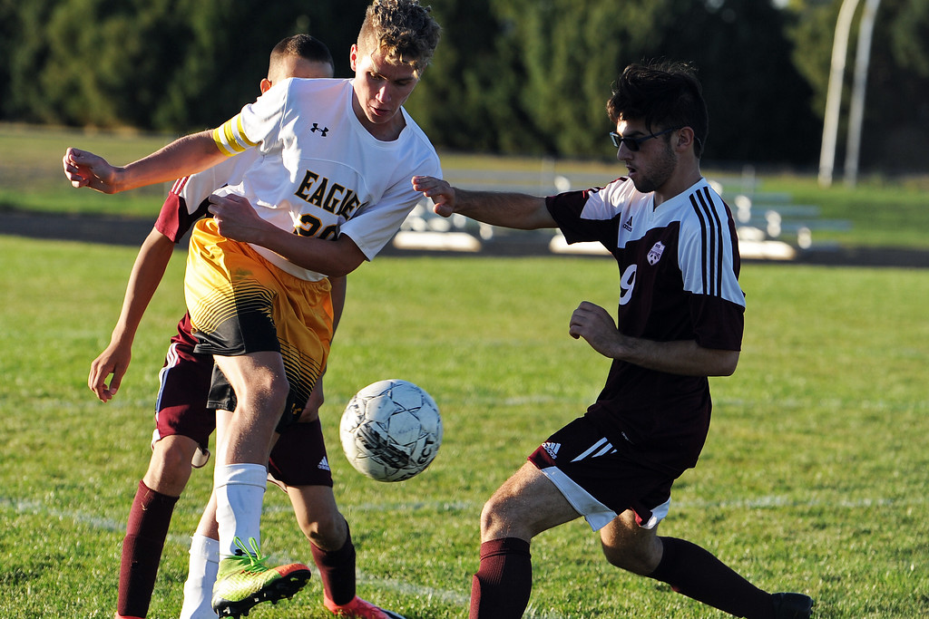. Thompson Valley\'s Logan Brian fights for possession with Berthoud\'s Sergey Eggers during a game Thursday, Sept. 20, 2018 at Berthoud High School. (Sean Star/Loveland Reporter-Herald)