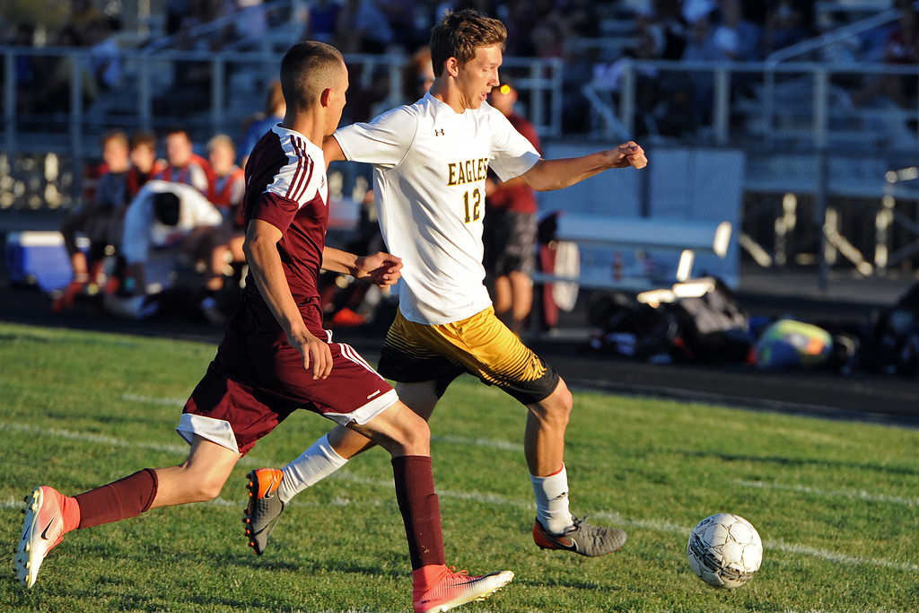 . Berthoud\'s Juancarlos Arreola chases Benjamin Lane during a game Thursday, Sept. 20, 2018 at Berthoud High School. (Sean Star/Loveland Reporter-Herald)