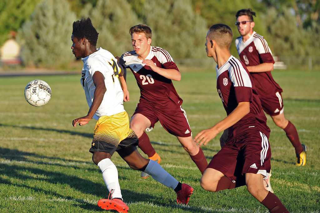 . Thompson Valley\'s Junio is pursued by a trio of Berthoud defenders during a game Thursday, Sept. 20, 2018 at Berthoud High School. (Sean Star/Loveland Reporter-Herald)