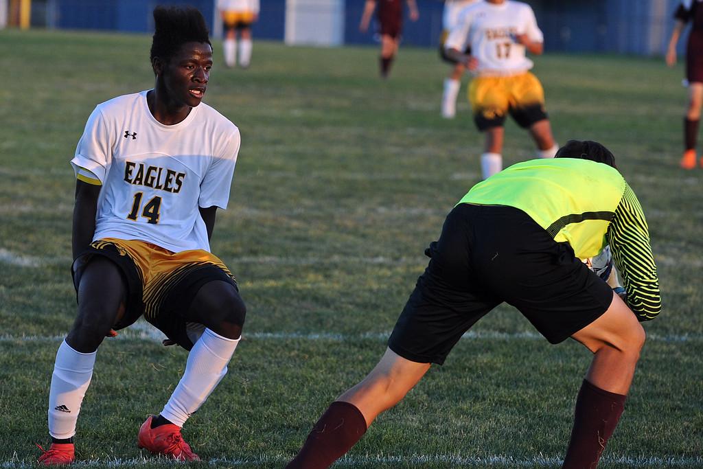 . Thompson Valley\'s Junio Lang pulls up as Berthoud goalie Kellan Marks grabs a loose ball during a game Thursday, Sept. 20, 2018 at Berthoud High School. (Sean Star/Loveland Reporter-Herald)