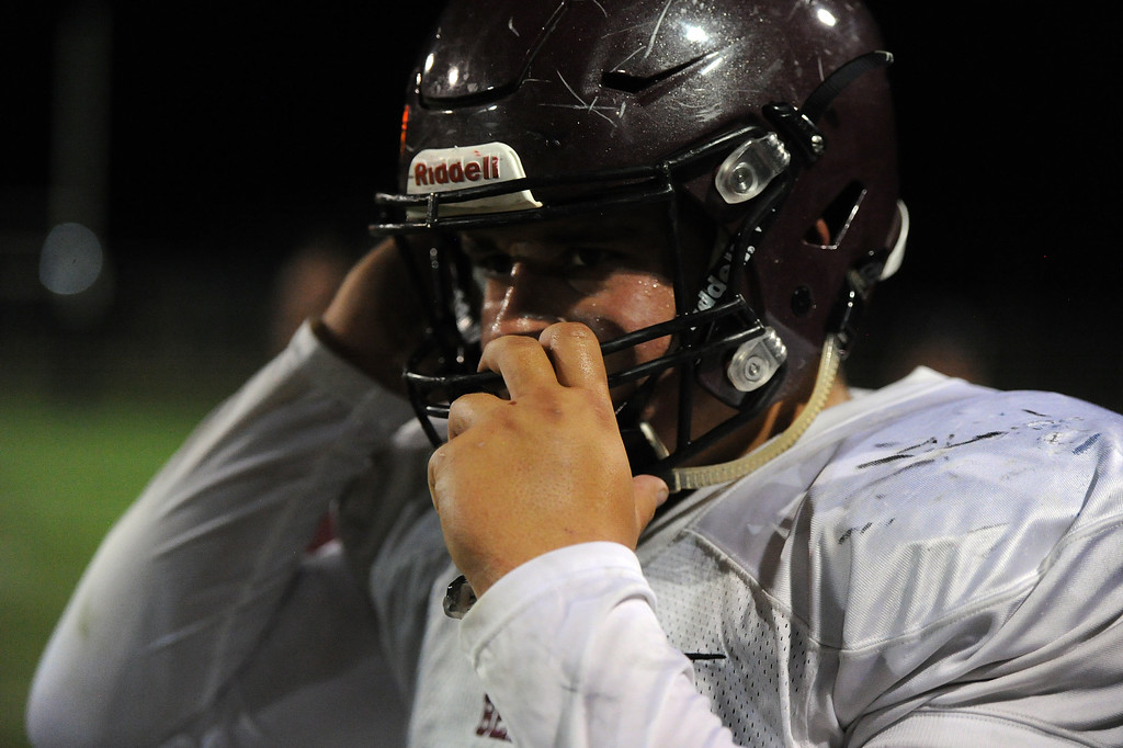 . Berthoud\'s Ty Beaman buckles his chinstrap during a game Friday, Sept. 14, 2018 at Patterson Stadium in Loveland, Colorado. (Sean Star/Loveland Reporter-Herald)