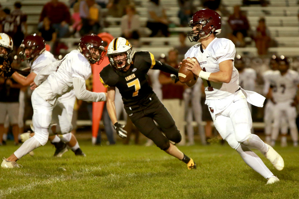 . Berthoud�s (1) Jacob Lozinski is chased by Eagle Valley�s (7) Jack Dyken as he looks for an opening on Sept. 14, 2018 at Patterson stadium in Loveland.(Photo by Taelyn Livingston/ Loveland Reporter-Herald)