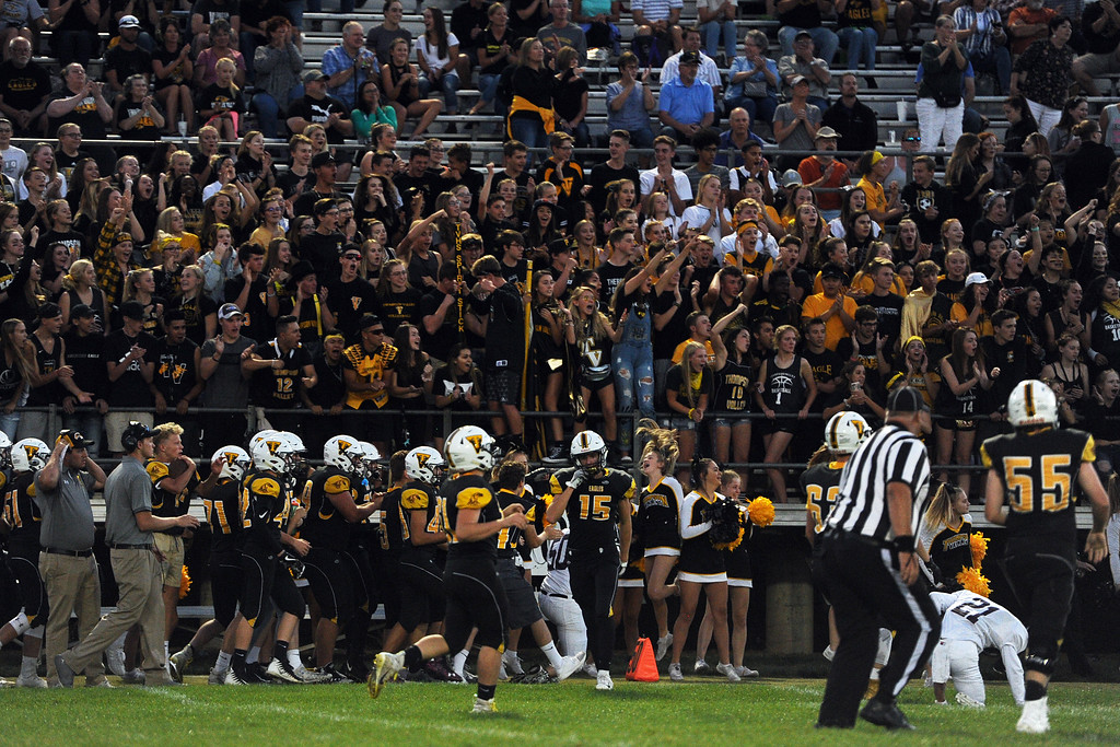 . Thompson Valley fans cheer on their Eagles after a big play during a game Friday, Sept. 14, 2018 at Patterson Stadium in Loveland, Colorado. (Sean Star/Loveland Reporter-Herald)