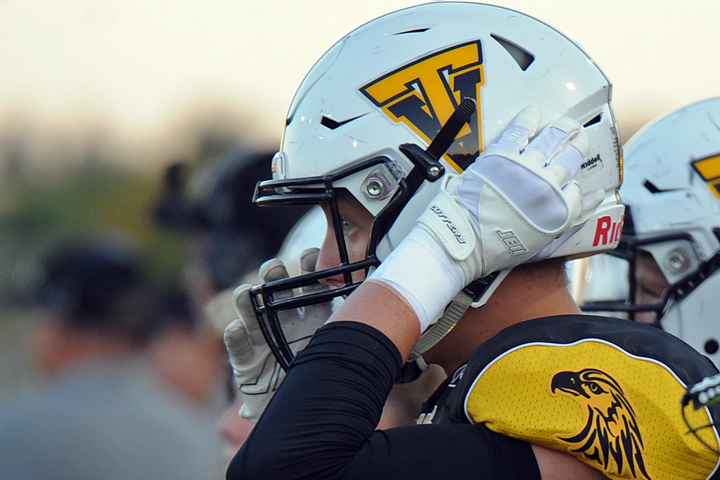 . Thompson Valley\'s Ti Smack straps up before a game against Berthoud on Friday, Sept. 14, 2018 at Patterson Stadium in Loveland, Colorado. (Sean Star/Loveland Reporter-Herald)