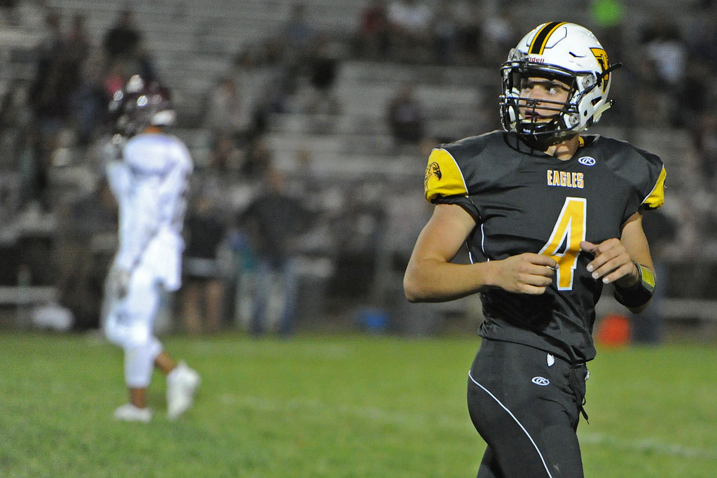 . Thompson Valley\'s Cameron Nellor looks at the scoreboard at the end of the first half during a game Friday, Sept. 14, 2018 at Patterson Stadium in Loveland, Colorado. (Sean Star/Loveland Reporter-Herald)