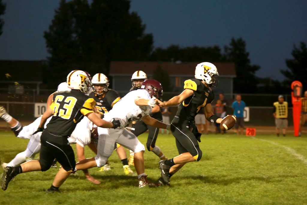 . Thompson Valley�s (4) Cam Nellor fends off his opponents of Berthoud High School at Patterson stadium in Loveland on Sept. 14, 2018.(Photo by Taelyn Livingston/ Loveland Reporter-Herald)