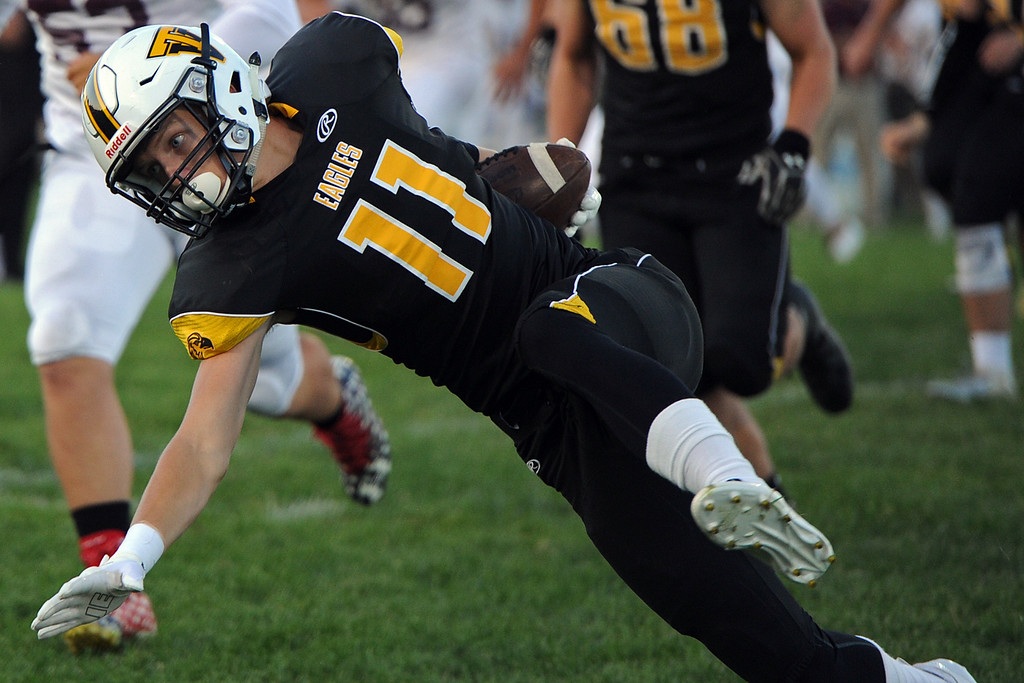 . Thompson Valley\'s Ti Smack finishes off a catch during a game Friday, Sept. 14, 2018 at Patterson Stadium in Loveland, Colorado. (Sean Star/Loveland Reporter-Herald)
