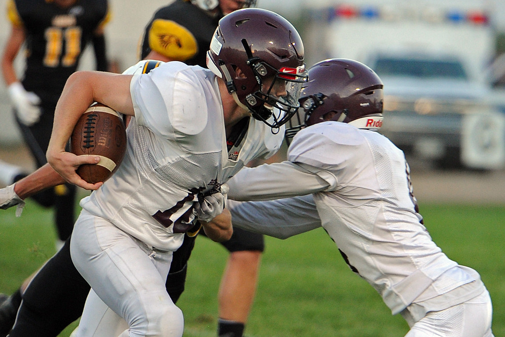 . Berthoud\'s Brennen Garvin breaks a tackle as he gets a block from teammate Austyn Binkly (right) during a game Friday, Sept. 14, 2018 at Patterson Stadium in Loveland, Colorado. (Sean Star/Loveland Reporter-Herald)