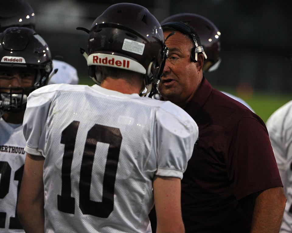 . Berthoud head coach Troy Diffendaffer talks to Brennen Garvin during a game Friday, Sept. 14, 2018 at Patterson Stadium in Loveland, Colorado. (Sean Star/Loveland Reporter-Herald)