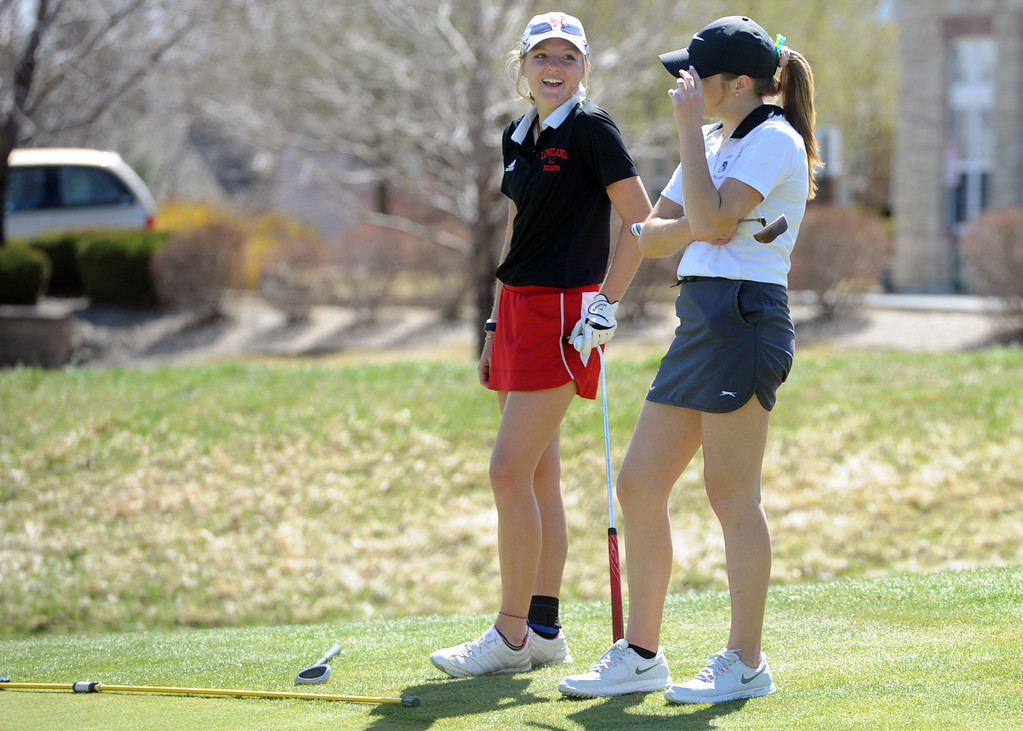 . Loveland\'s Lauren Lehigh talks with Mountain View\'s Renee Demaree during the Loveland Invitational at the Olde Course on Wednesday, April 11, 2018. (Sean Star/Loveland Reporter-Herald)