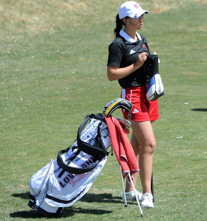 . Loveland\'s Natalee Hall replaces her head cover on the 13th tee during the Loveland Invitational on Wednesday, April 11, 2018 at the Olde Course at Loveland. (Sean Star/Loveland Reporter-Herald)