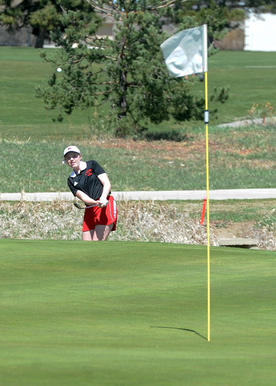 . Loveland\'s Taylor Bandemer watches her chip during the Loveland Invitational on Wednesday, April 11, 2018 at the Olde Course at Loveland. (Sean Star/Loveland Reporter-Herald)