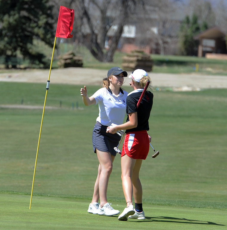 . Mountain View\'s Renee Demaree, left, hugs Lauren Lehigh after finishing their round during the Loveland Invitational on Wednesday, April 11, 2018 at the Olde Course at Loveland. (Sean Star/Loveland Reporter-Herald)
