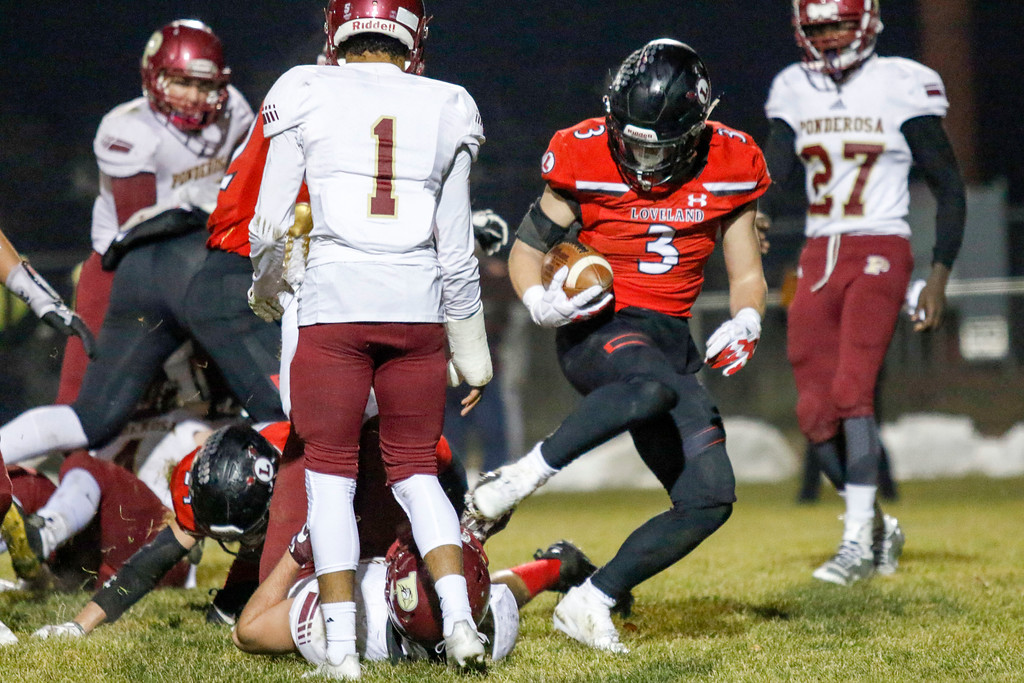 . Loveland�s Zach Weinmaster (3) steps over the goal line, scoring the second touchdown of the night,  on Friday, Nov. 10, 2017, at Patterson Stadium in Loveland. (Photo by Lauren Cordova/Loveland Reporter-Herald)