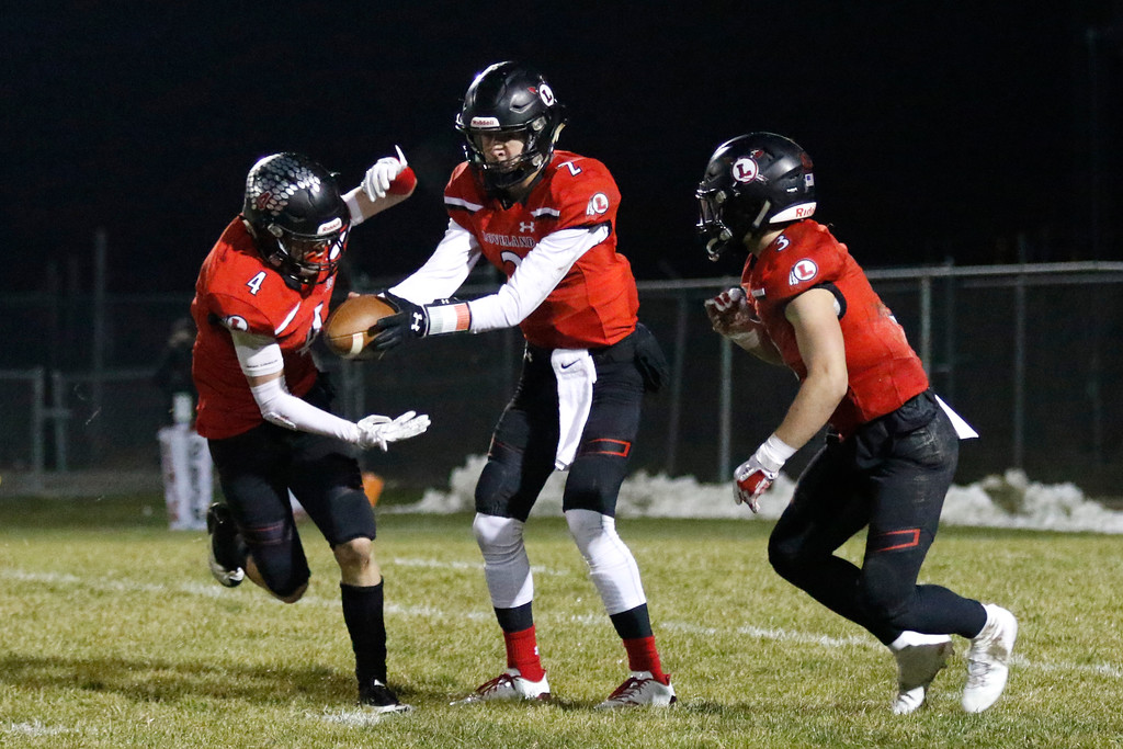 . Loveland�s Riley Kinney (2) fakes a pass to Cody Rakowsky (4) while Zach Weinmaster (3) waits for the ball  on Friday, Nov. 10, 2017, at Patterson Stadium in Loveland. (Photo by Lauren Cordova/Loveland Reporter-Herald)