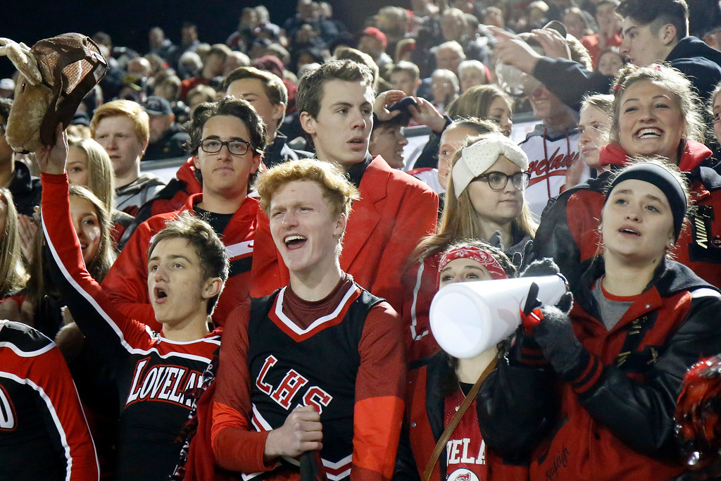 . Loveland Seniors Henry Stucky, Ty McCaffrey, Camryn Kelley and Kayleigh Hillyard cheer for the Indians as they enter the field for their playoff game against Ponderosa on Friday, Nov. 10, 2017, at Patterson Stadium in Loveland. (Photo by Lauren Cordova/Loveland Reporter-Herald)