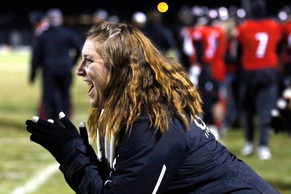 . Loveland�s athletic trainer Ashley Smith cheers for Isaiah Meyers (1) as he blocks a pass at the goal line on Friday, Nov. 10, 2017, at Patterson Stadium in Loveland. (Photo by Lauren Cordova/Loveland Reporter-Herald)