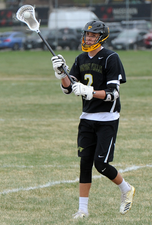 . Thompson Valley\'s Riley Kinney makes a pass during a game on Thursday, April 19, 2018 at Dawson School in Lafayette, Colorado. (Sean Star/Loveland Reporter-Herald)