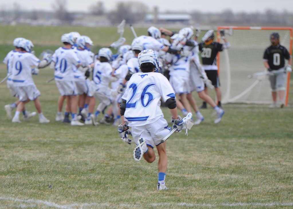 . Dawson\'s Jack Ridilla (26) sprints to join his teammates in celebration after a last-second, game-winning goal by Jackson Keener on Thursday, April 19, 2018 at Dawson School in Lafayette, Colorado. (Sean Star/Loveland Reporter-Herald)