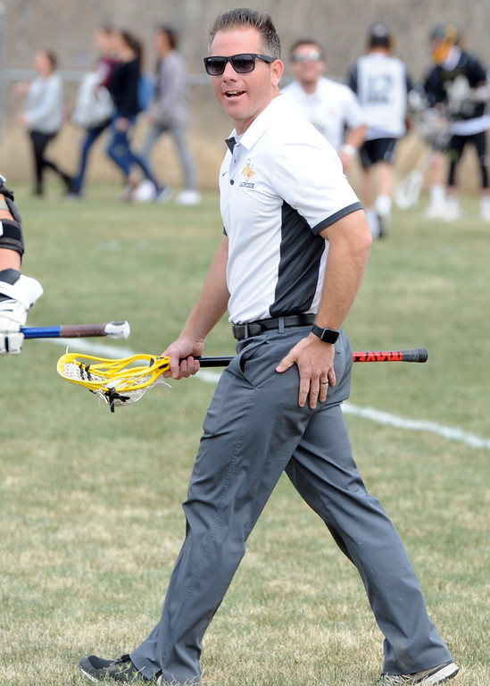 . Thompson Valley coach Will Cantwell gets his team ready for a game on Thursday, April 19, 2018 at Dawson School in Lafayette, Colorado. (Sean Star/Loveland Reporter-Herald)