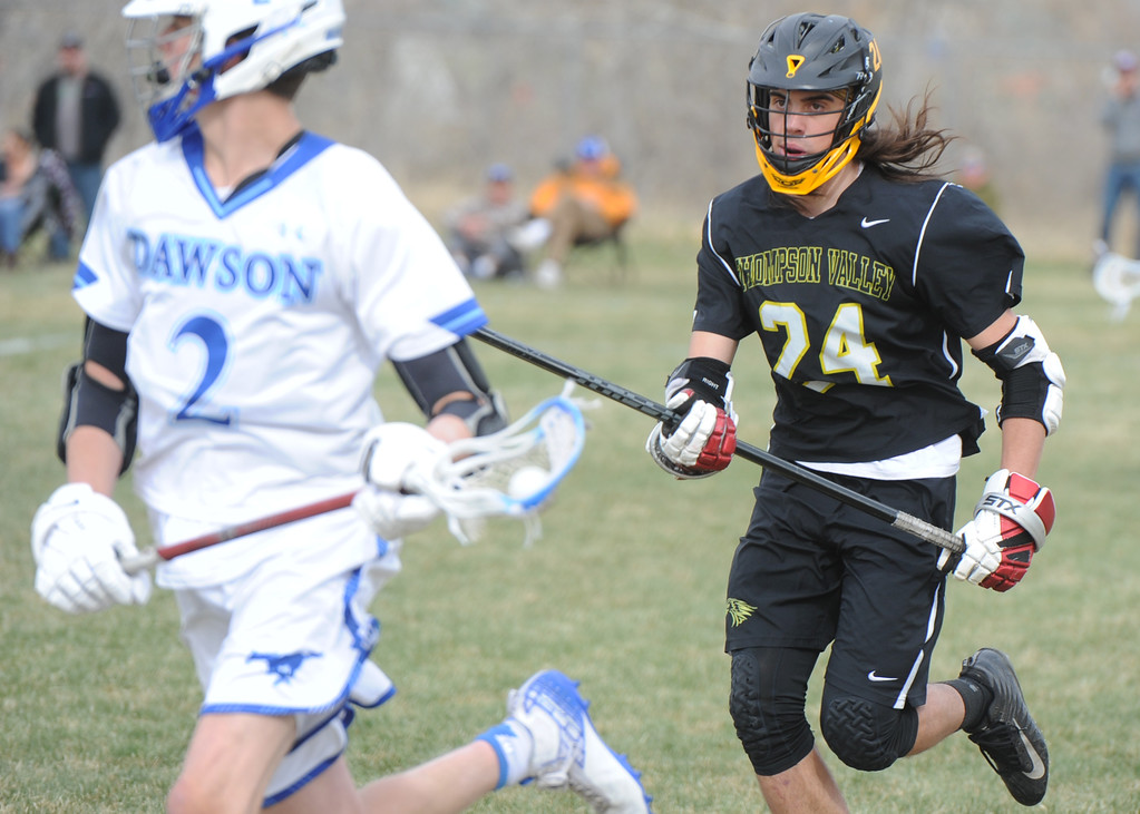. Thompson Valley\'s Trey Cardenas (24) chases down Dawson\'s Gavyn Pure during their game Thursday, April 19, 2018 in Lafayette, Colorado. (Sean Star/Loveland Reporter-Herald)